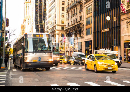NEW YORK CITY - OCTOBER 15, 2015: Midtown Manhattan street view along the upscale shopping district on 5th Avenue - Stock Photo