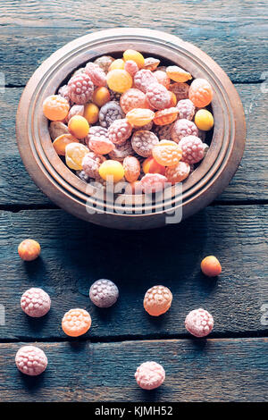 Colorful bonbons on wooden background,selective focus - Stock Photo