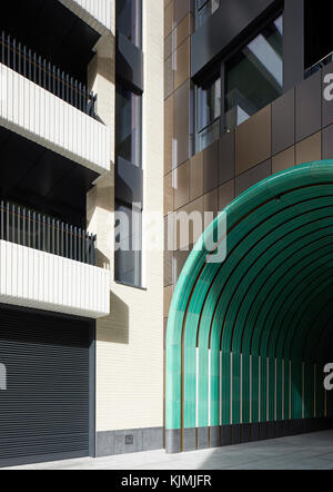 View from courtyard towards tunneled entrance. Rathbone Square, London, United Kingdom. Architect: Make Ltd, 2017. - Stock Photo