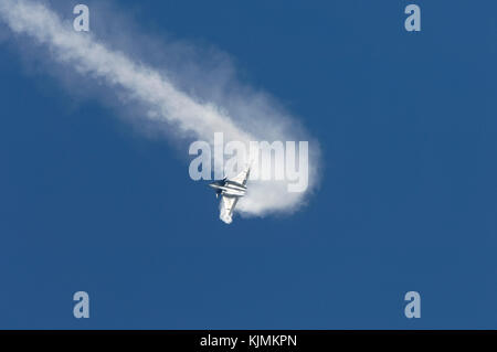 aerobatic flying-display with white smoke at the 2005 Paris AirShow, Salon-du-Bourget - Stock Photo