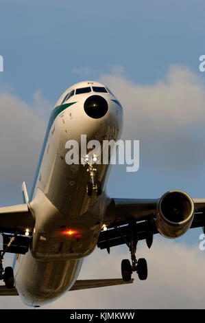 final-approach landing with red rotating beacon light flashing - Stock Photo