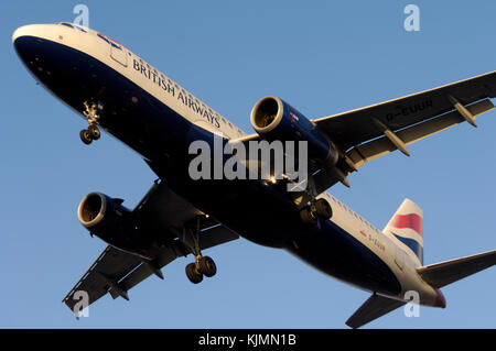 IAE V2527-A5 engine cowlings, nosewheel and mainwheel undercarriage of a British Airways Airbus A320-200 on final - Stock Photo