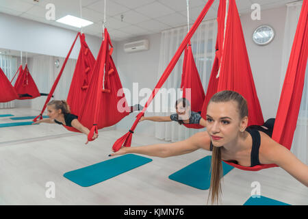 Fitness womans doing relaxing yoga in the air. Beauty. Health - Stock Photo