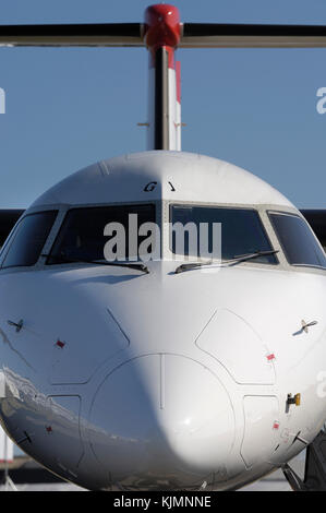 windshield and tail-fin of the Austrian Arrows Bombardier DHC-8 Dash 8-400 Q400 at the 2006 Farnborough International - Stock Photo