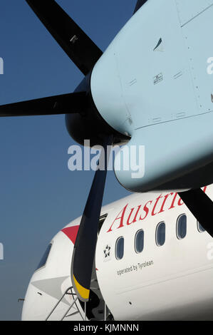 PW150A engine cowling, propellers, windows and windshield of the Austrian Arrows Bombardier DHC-8 Dash 8-400 Q400 - Stock Photo