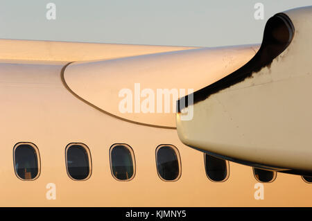 windows, wing fairing and the PW150A engine cowling of the Austrian Arrows Bombardier DHC-8 Q400 parked in the static - Stock Photo