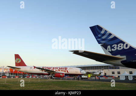 Kingfisher Airlines Airbus A320-200 and tail-fin of the A380-800 parked in the static-display at the 2006 Farnborough - Stock Photo