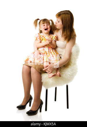 Daughter crying sitting on mother's hands isolated on white - Stock Photo