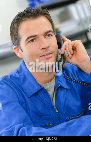 Artisan speaking on the phone - Stock Photo