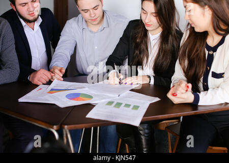 Managers of two men and women are engaged in approving programs  - Stock Photo