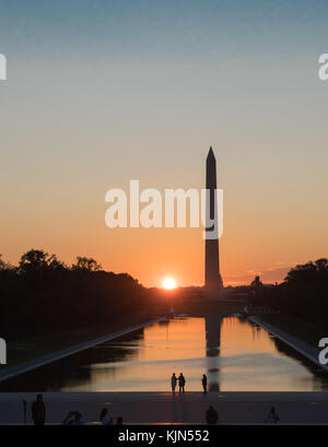 Washington Monument at dusk, dawn, sunrise, sunset, twilight - reflection and peace - Stock Photo