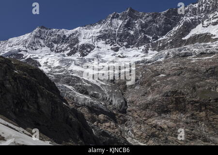 The high ridges of Allalinhorn and its glaciers, above Saas-Fee, Switzerland. - Stock Photo