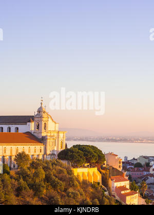 LISBON, PORTUGAL - NOVEMBER 19, 2017: Cityscape of Lisbon, Portugal, with Igreja de convento da Graca, at sunset - Stock Photo