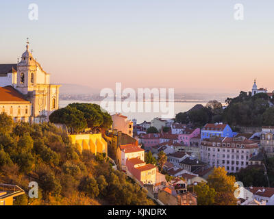 Cityscape of Lisbon, Portugal, with Igreja de convento da Graca, at sunset on a November day, - Stock Photo