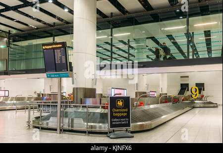 London Gatwick, UK - November 21st, 2017: Baggage carousel in airport, South Terminal, London Gatwick, England - Stock Photo