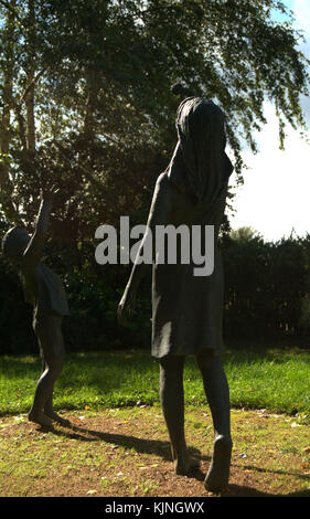 The Seeds Of Hope sculpture by Christine Charlesworth, a bronze sculpture of two children playing. Located in the - Stock Photo