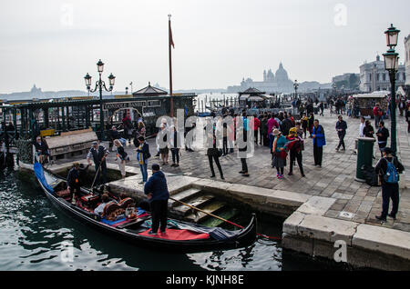 Venice is the capital of the Veneto region. It is situated across a group of 118 small islands[1] that are separated - Stock Photo