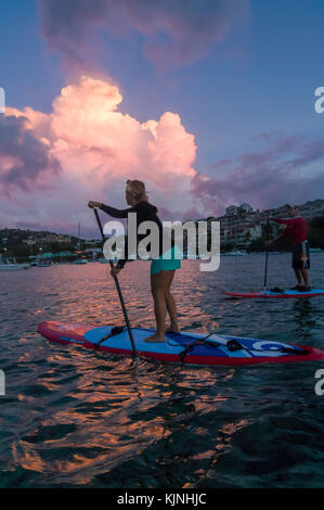 Standup paddle boarding in Cruz Bay - Stock Photo