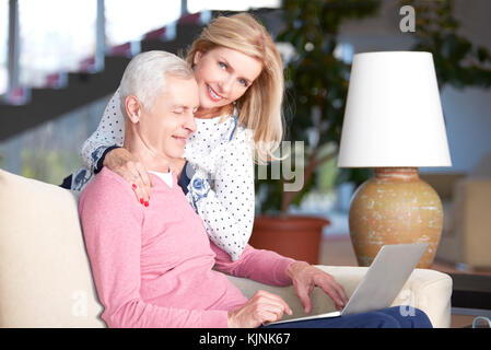 Shot of a happy senior relaxing at home. Beautiful mature woman ...