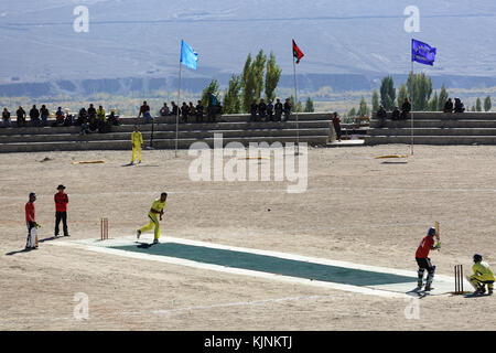 Local cricket players during the match, Leh, Ladakh, Jammu and Kashmir, India. - Stock Photo