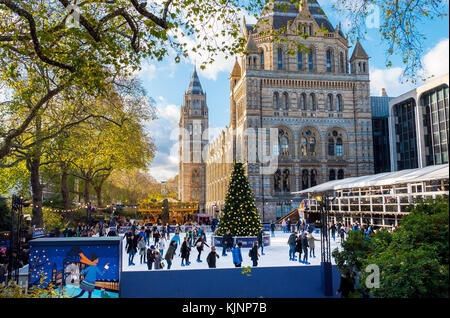 The Christmas Ice Rink at the Natural History Museum in London - Stock Photo
