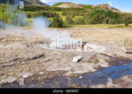 travel to Iceland - Little Geyser (Litli-Geysir) in Haukadalur hot spring valley in autumn - Stock Photo