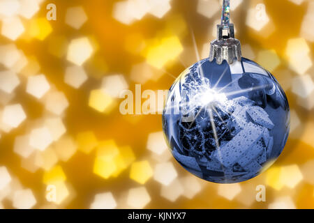 Christmas tree with plenty of presents in mirror from shiny ball. Hanging blue bauble with star on yellow abstract - Stock Photo