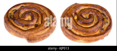 Two pieces of sweet curled pastry with vanilla filling. Delicious fragrant breakfast of golden color with raisins. - Stock Photo