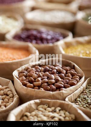 Pulses in paper bags. - Stock Photo