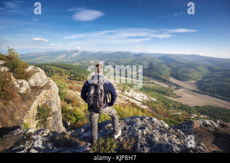Traveler on peak of mountain. Nature and adventure composition - Stock Photo