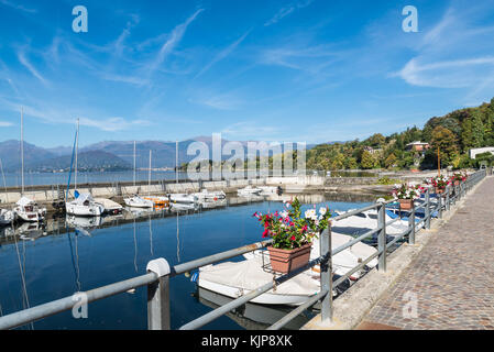 Town of Reno, lake Maggiore, northern Italy. Lakefront of the picturesque village on Lake Maggiore and its small - Stock Photo