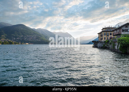 Como lake, Como city, northern Italy. View of Lake Como by the end of the lakefront promenade of Como town. In the - Stock Photo