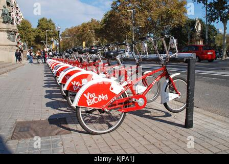 A row of bicycles on a Viu Bicing station in Barcelona, Spain on November 1, 2017. The cycle sharing scheme was - Stock Photo