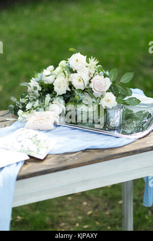 present, women day, sentiment concept. on the shining silver tray there is bouquet of creamy white roses decorated - Stock Photo