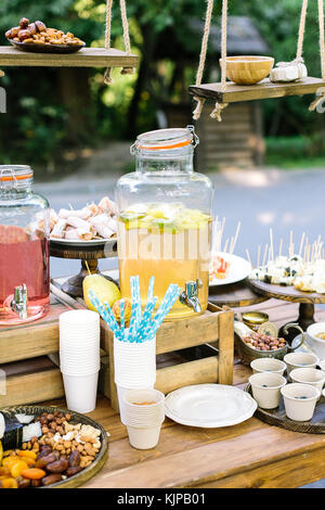 meal, summer, plesure concept. there are different types of fruit juices, nuts, dried fruits in the paper cups and - Stock Photo