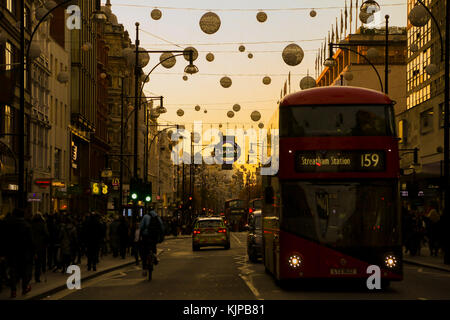 Oxford Street. London, UK. 24th Nov, 2017. Sunsetting over Oxford Street on Black Friday as tens of thousands of people take advantage of Black Friday deals. Black Friday is a sales offer originating from the US where retailers slash prices on the day after the Thanksgiving holiday. Credit: Dinendra Haria/Alamy Live News Stock Photo