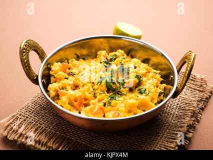 Zunka Bhakar Pithla or pitla, popular vegetarian recipe from India - Stock Photo