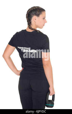 Female Personal Trainer, with her back facing the camera, isolated - Stock Photo