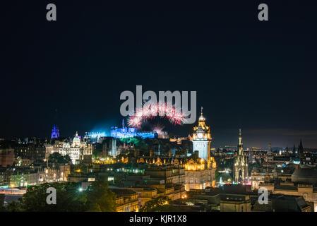 EDINBURGH, SCOTLAND - AUGUST 15, 2017 - The scenic summer fireworks in Edinburgh during the Royal Military Tattoo - Stock Photo