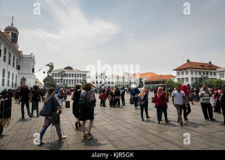 Indonesia - October 2017: Crowd of people at Jakarta Old Town square, a popular tourist destination, in Jakarta. - Stock Photo