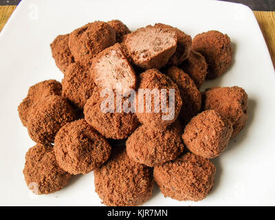 Homemade drunk balls, cold creamy dessert made with cocoa, mascarpone, sugar, crushed biscuits dust, and liquor - Stock Photo