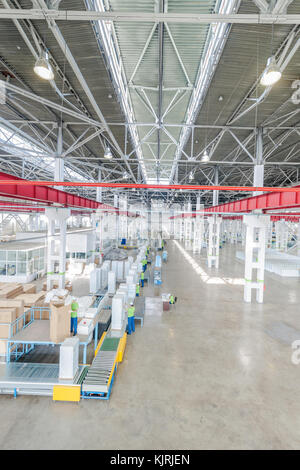 Factory Floor For Production And Assembly Of Household Refrigerators On The Conveyor Belt Workers