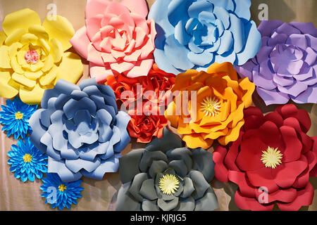 Paper colorful flowers as a beautiful background - Stock Photo