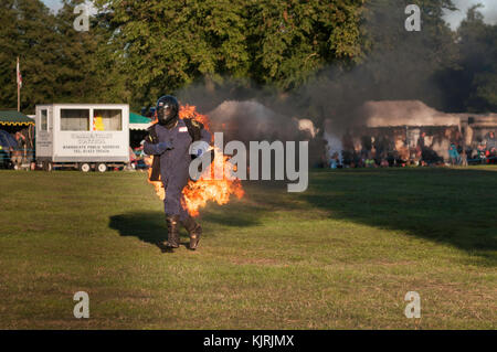 Astle Park, Cheshire, UK - August 12 2017: A stuntman on fire at Astle Park Traction Engine Rally - Stock Photo