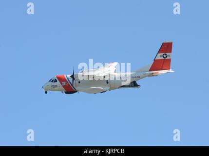 Miami, USA - November 11, 2012: US Coast Giard patrol airplane departs from Miami on a monitoring patrol mission - Stock Photo