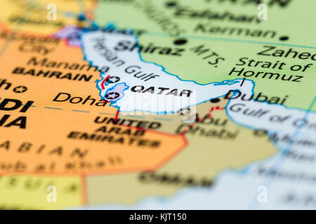 close up of a world map with the country of Qatar in focus - Stock Photo