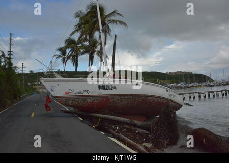 U.S. Coast Guard officers locate a damaged and displaced boat during relief efforts in the aftermath of Hurricane - Stock Photo