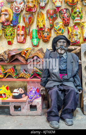 Traditional masks and the mayan deity Maximón in a souvenir shop | Antigua | Guatemala