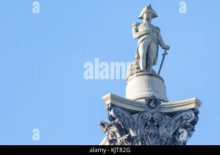 The famous statue of Admiral Nelson on Trafalgar Square in London, UK, on blue clear sky - Stock Photo