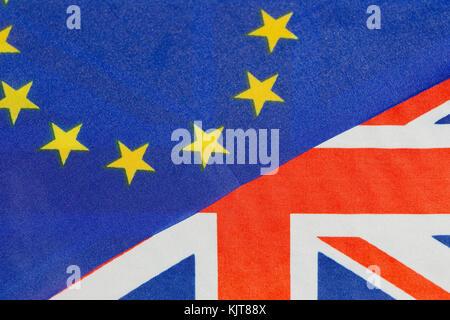 The European Union flag and the United Kingdom flag together. - Stock Photo